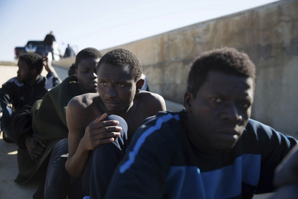 FILE - In this March 3, 2017 file photo, migrants rest after they were rescued by the Libyan Coast Guard off the coast of Tripoli, Libya. The U.N. and