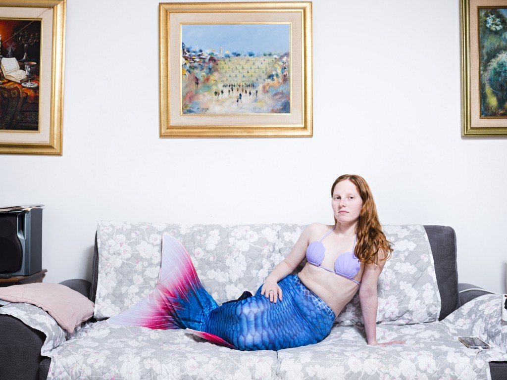 In this Tuesday, March. 26, 2019 photo, Vered Klein, a member of the Israeli Mermaid Community, poses for a portrait as she wears a mermaid tail at he...