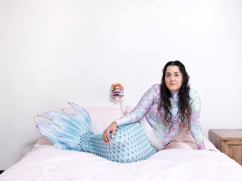 In this Monday, Feb. 18, 2019, photo, Chen Amsalem, a member of the Israeli Mermaid Community, poses for a portrait as she wears a mermaid tail at her