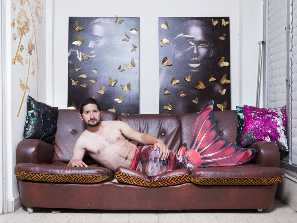 In this Thursday, Feb. 28, 2019 photo, Gal Amnony, a member of the Israeli Mermaid Community, poses for a portrait as he wears a tail at his home in R...