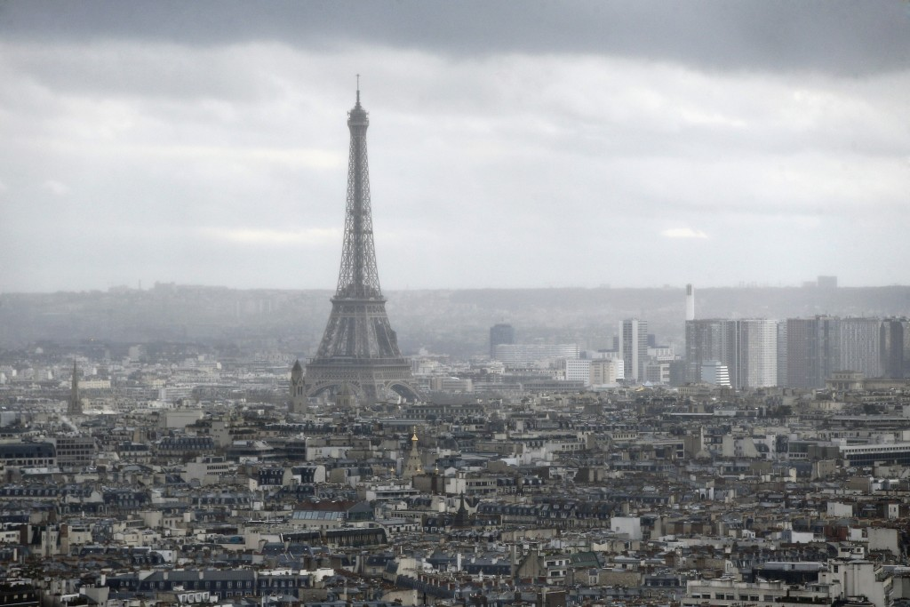 FILE - This Tuesday, March 27, 2018 file photo shows the Eiffel Tower from the Paris new courthouse, in Paris. Monuments are the emotional backbone of