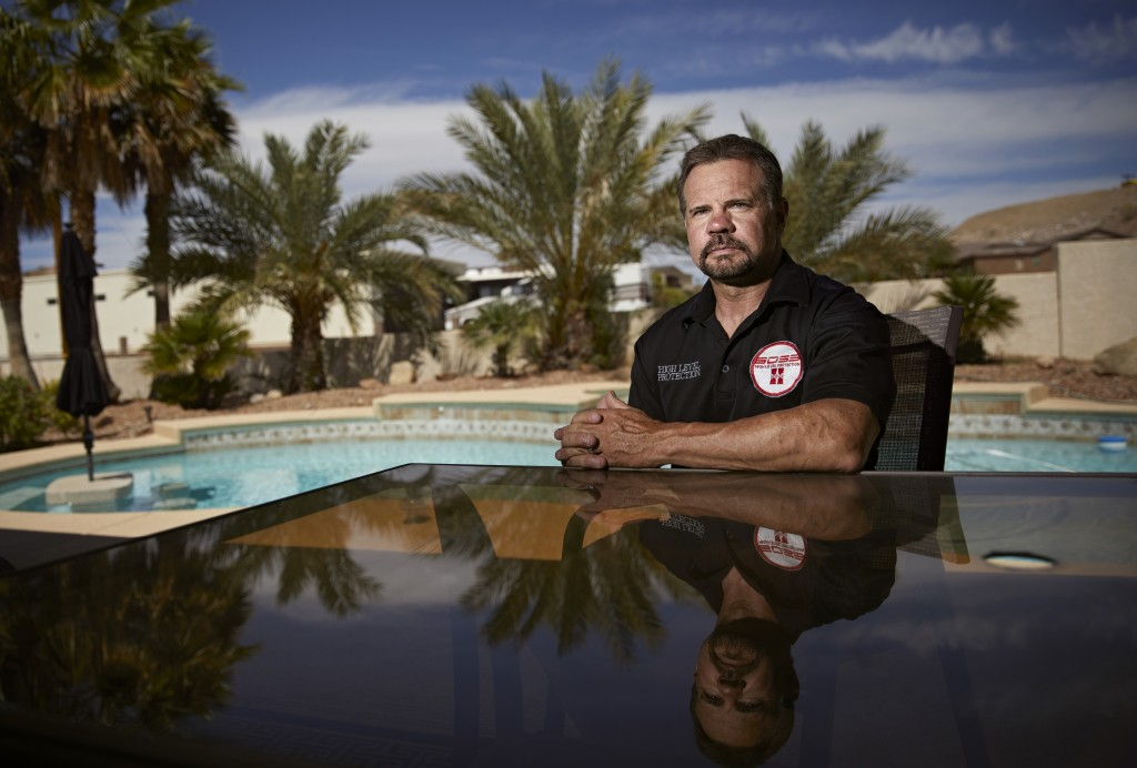 In this April 9, 2019, photo, Grant Whitus poses for a portrait at his home in Lake Havasu City, Ariz. Whitus' marriage fell apart a year after he led...