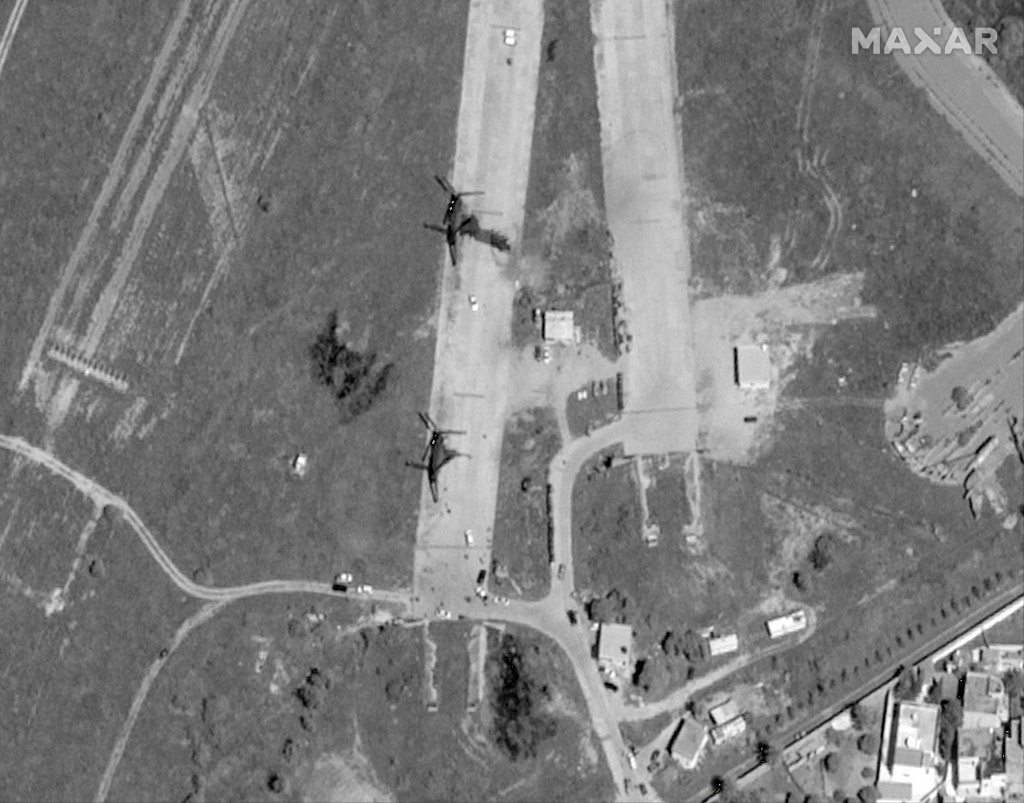 FILE - This Monday, April 8, 2019 file handout satellite image, provided by Maxar, shows Mitiga airport after a reported airstrike by the self-styled