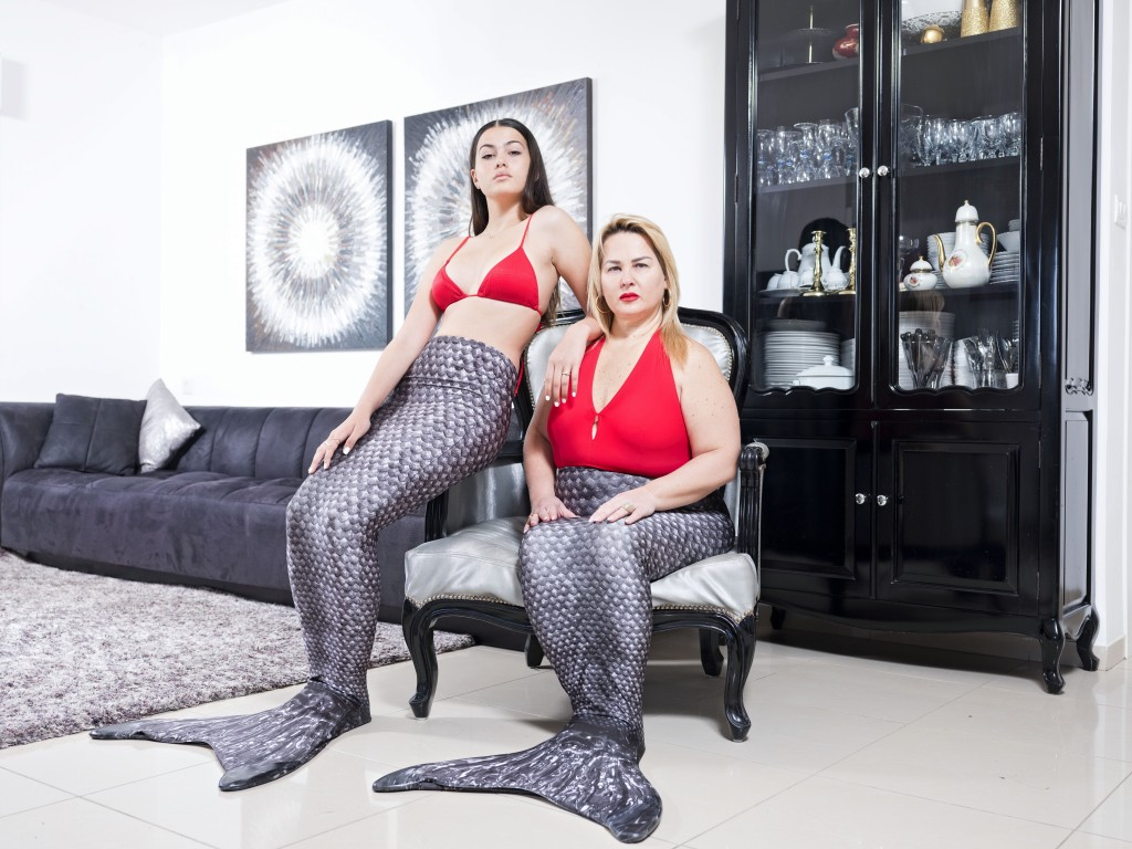 In this Wednesday, March. 6, 2019 photo, Limor Kahlon, right, and her daughter Yam, members of the Israeli Mermaid Community, pose for a portrait as t...
