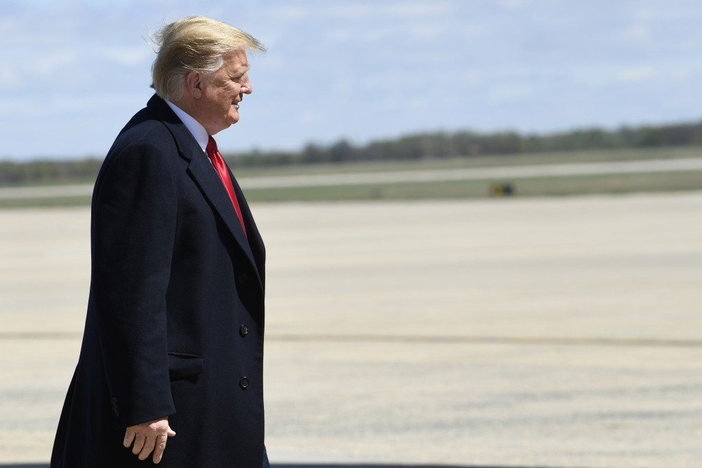 President Donald Trump walks towards the steps of Air Force One at Andrews Air Force Base in Md., Monday, April 15, 2019. Trump is heading to Minnesot