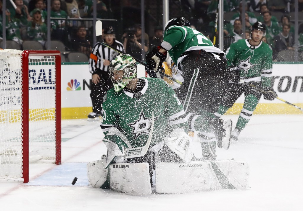Dallas Stars goaltender Ben Bishop (30) looks back to see the puck shoot back out of the goal after Nashville Predators' cRocco Grimaldi's score in th