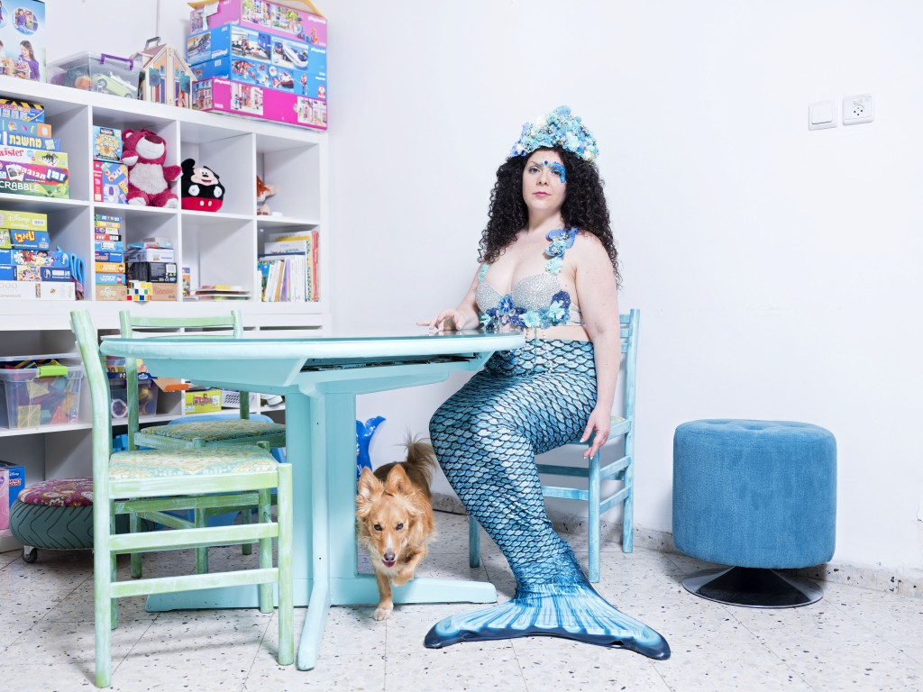In this Monday, March. 4, 2019 photo, Inbar Ben Yakar, a member of the Israeli Mermaid Community, poses for a portrait as she wears a mermaid tail at ...