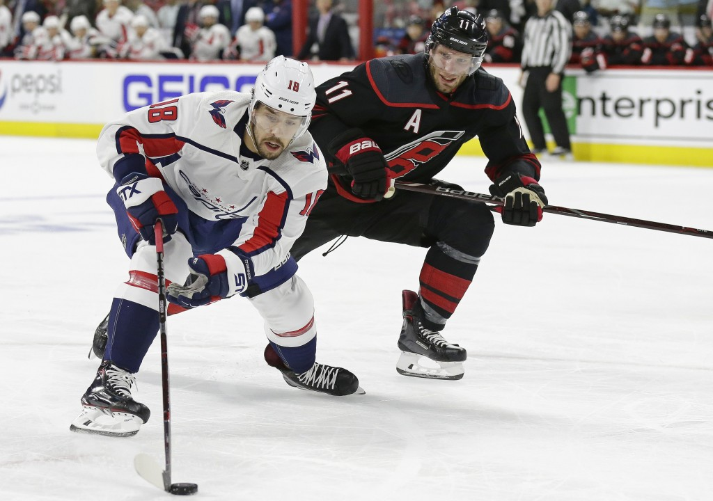 Carolina Hurricanes' Jordan Staal (11) defends against Washington Capitals' Chandler Stephenson (18) during the first period of Game 3 of an NHL hocke...