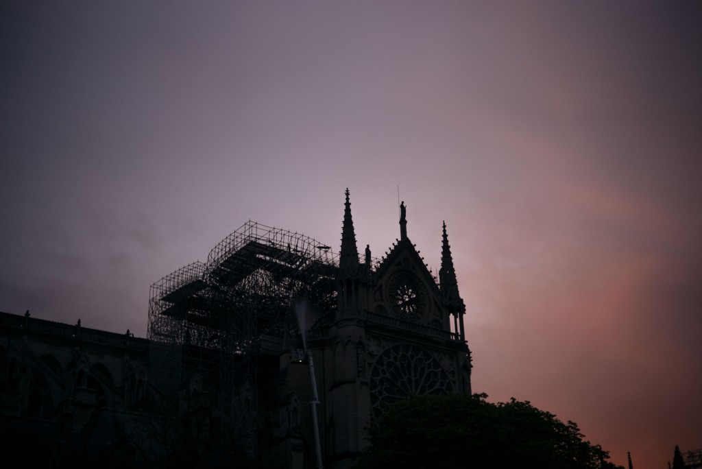 The Notre Dame cathedral is seen on sunrise after the fire in Paris, Tuesday, April 16, 2019. A catastrophic fire engulfed the upper reaches of Paris'