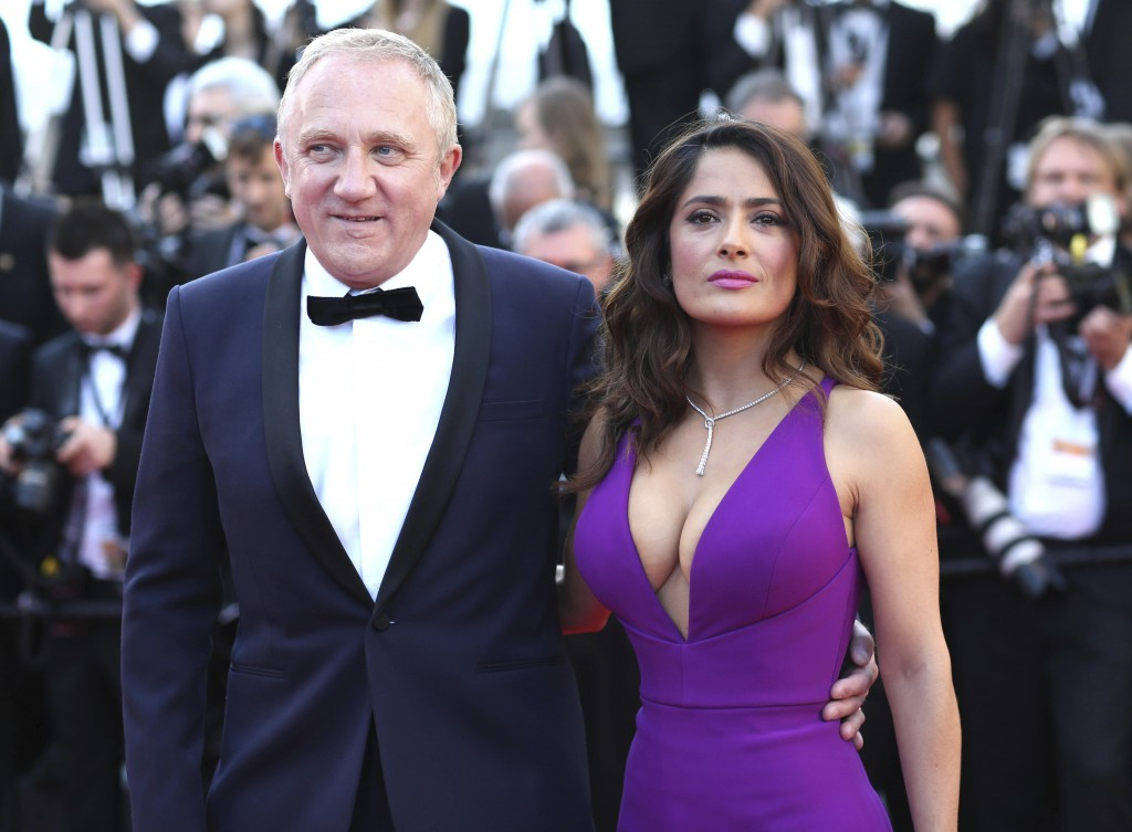 FILE - In this Sunday, May 17, 2015 file photo Francois-Henri Pinault and Salma Hayek pose for photographers upon arrival for the screening of the fil