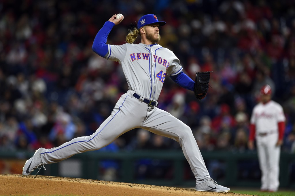 New York Mets starting pitcher Noah Syndergaard throws during the third inning of a baseball game against the Philadelphia Phillies, Monday, April 15,