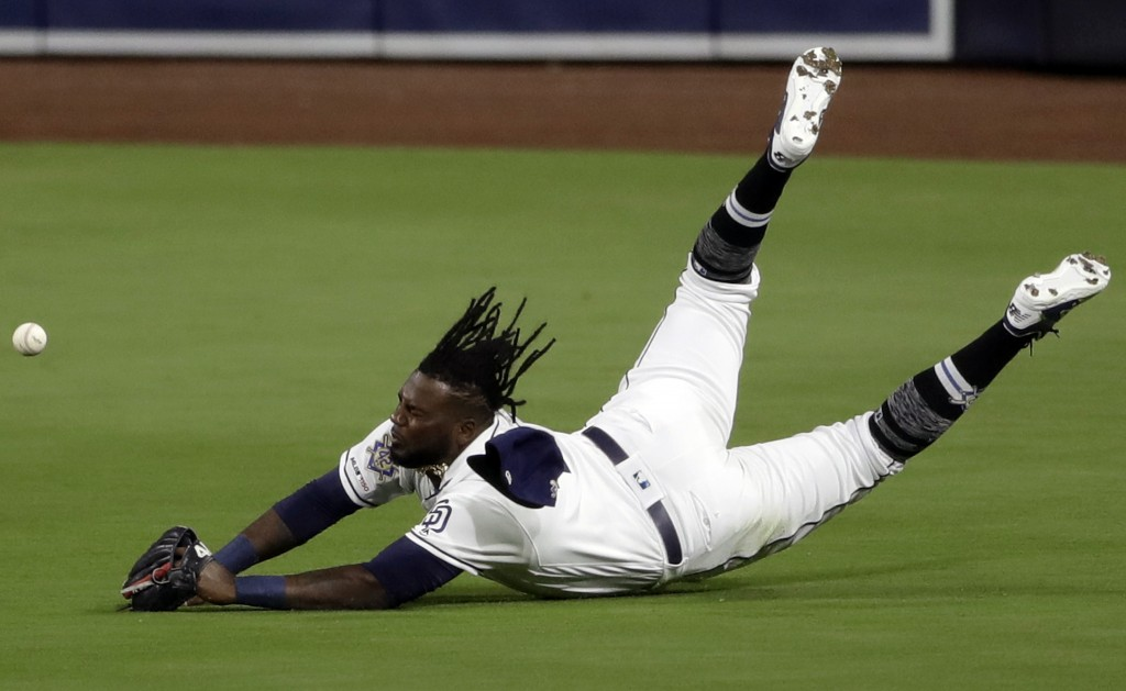 San Diego Padres center fielder Franmil Reyes misses the catch of a double hit by Colorado Rockies' Ian Desmond during the second inning of a baseball