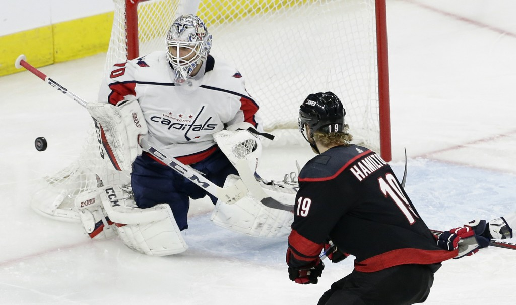 Carolina Hurricanes' Dougie Hamilton (19) shoots on goal while Washington Capitals goalie Braden Holtby (70) defends during the second period of Game