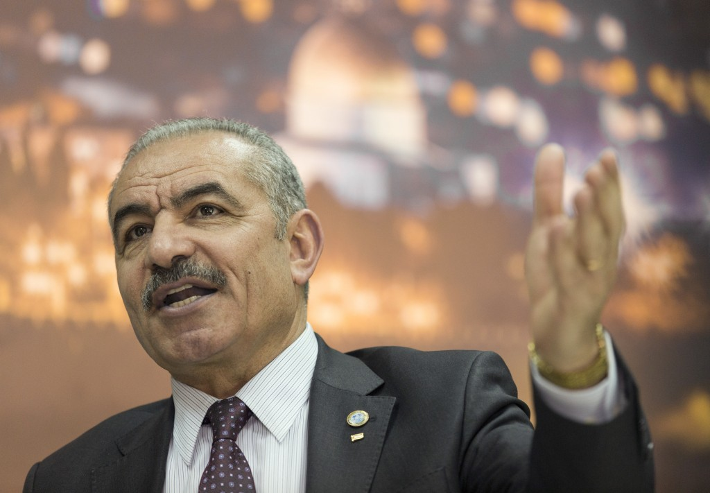 Palestinian Prime Minister Mohammad Shtayyeh italks during an interview with The Associated Press, at his office in the West Bank city of Ramallah, Tu