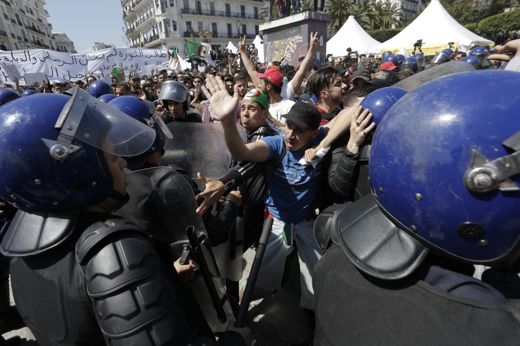 Students carry banners and chant slogans during a demonstration in Algiers, Algeria, Tuesday, April 16, 2019. President of the Algerian Constitutional