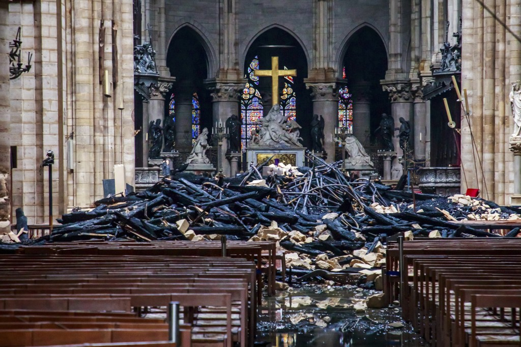 A hole is seen in the dome inside Notre Dame cathedral in Paris, Tuesday, April 16, 2019. Firefighters declared success Tuesday in a more than 12-hour