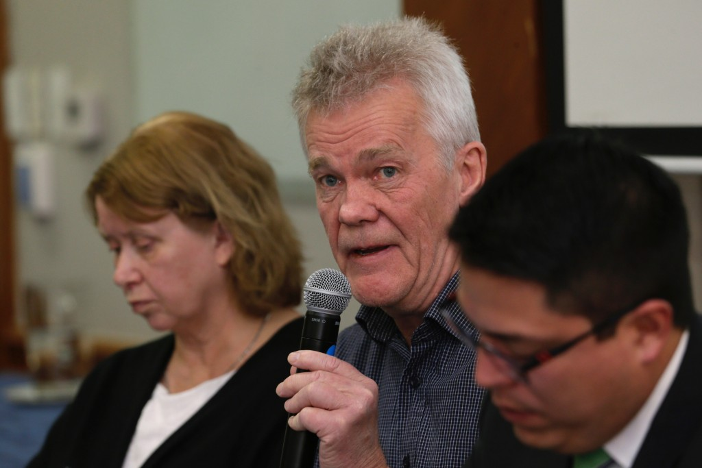 The father of detained Swedish programmer Ola Bini, Dag Gustafsson, speaks at a press conference flanked by his wife Gorel Bini, and his son's lawyer