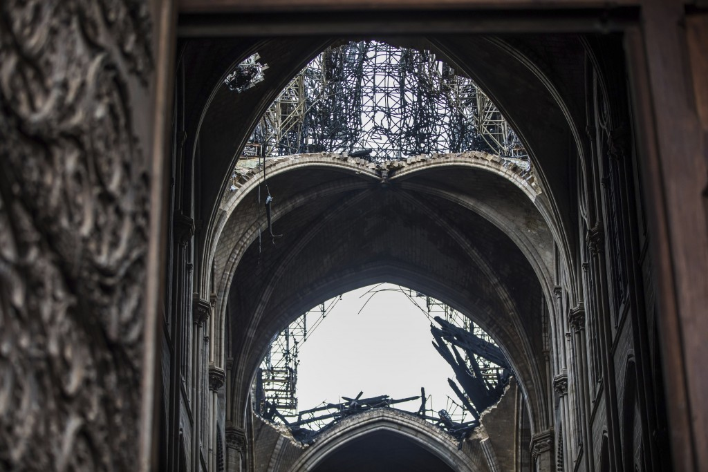 Holes seen in the dome inside the damaged Notre Dame cathedral in Paris, Tuesday, April 16, 2019. Firefighters declared success Tuesday in a more than