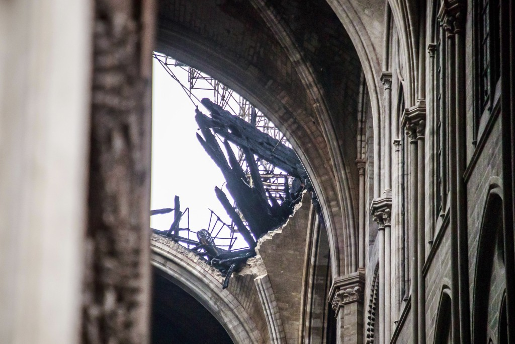 A hole is seen in the dome inside the damaged Notre Dame cathedral in Paris, Tuesday, April 16, 2019. Firefighters declared success Tuesday in a more