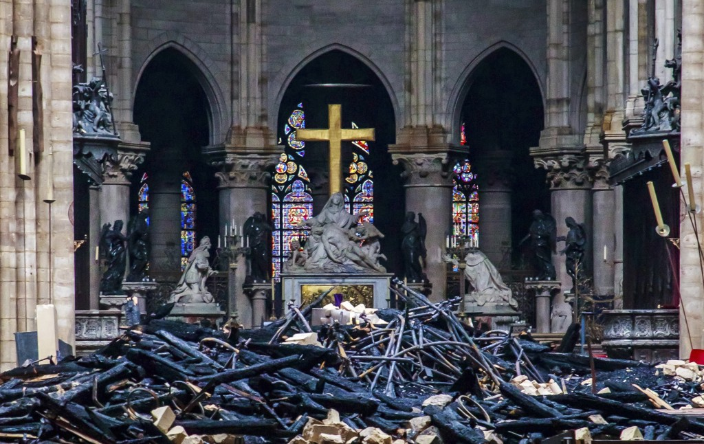 Debris are seen inside Notre Dame cathedral in Paris, Tuesday, April 16, 2019. Firefighters declared success Tuesday in a more than 12-hour battle to