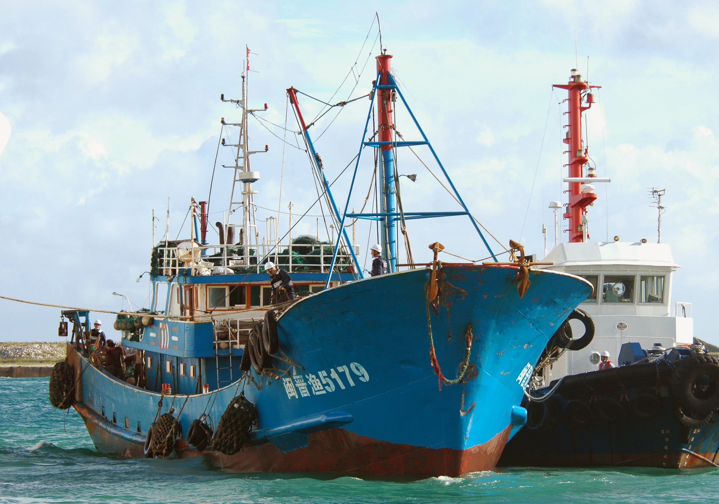 A Chinese fishing boat, left, accompanied by a Japan Coast Guard boat, right, is led into a port on Ishigaki island, southwestern Japan on Wednesday....