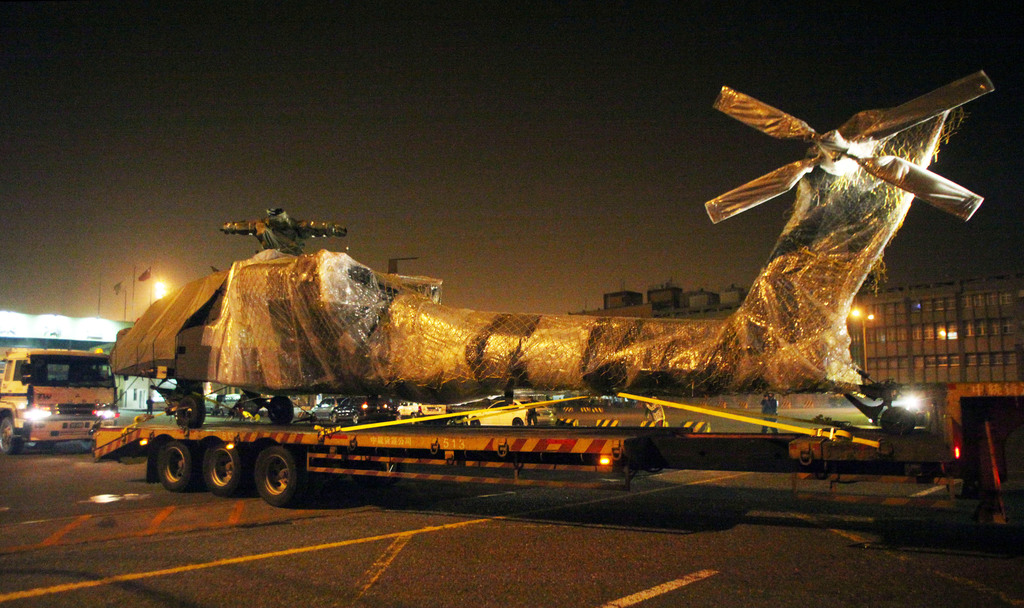 Three of the six AH-64E Apache attack  helicopters that arrived in Kaohsiung on Jan. 2 were trucked from the  port to an air base in nearby Tainan ear...