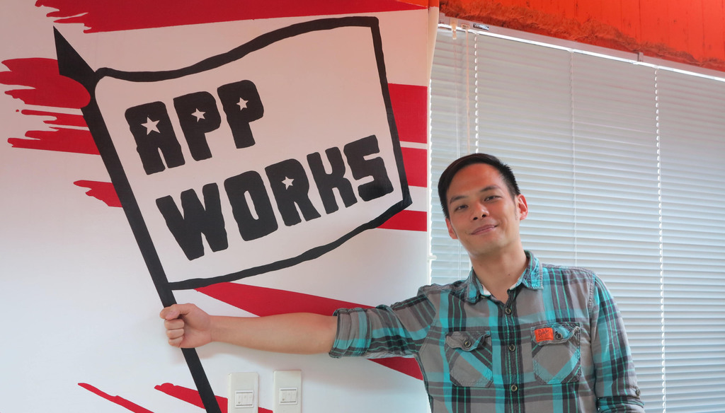 Jamie Lin, founder of Taiwanese startup AppWorks posing with the company logo.