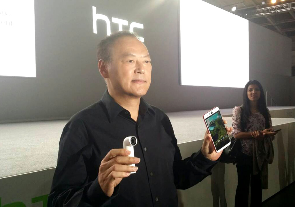 HTC CEO Peter Chou displays the RE camera (left) and Desire Eye in New York.