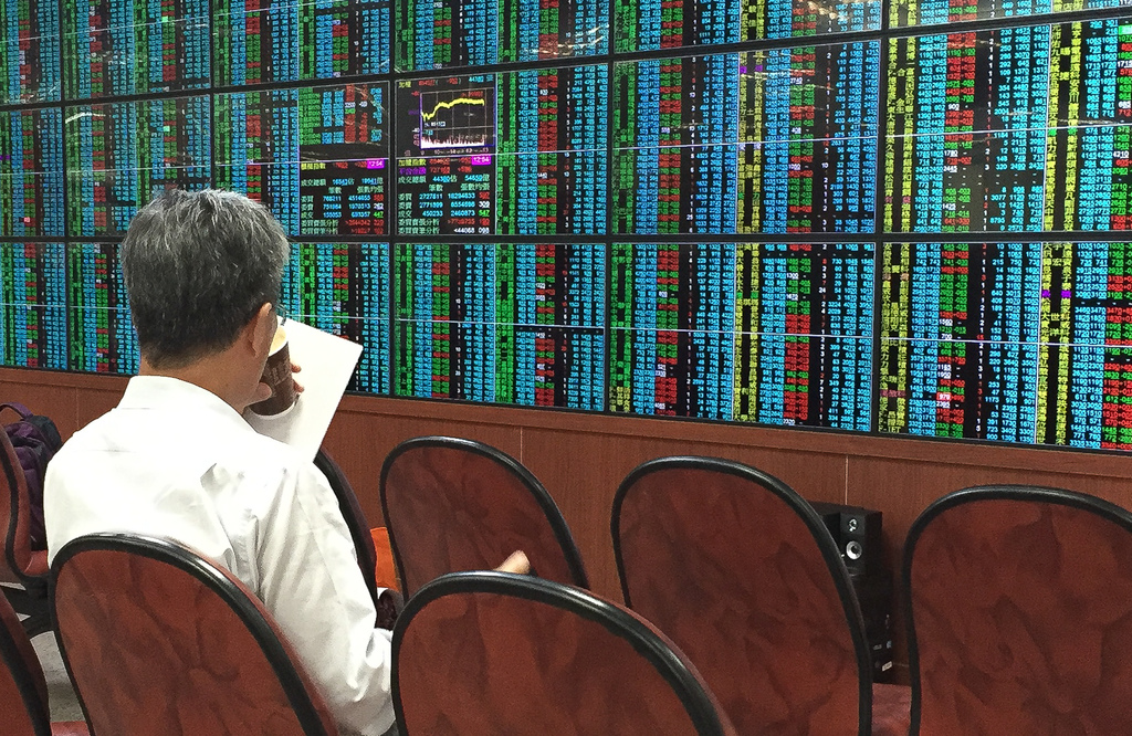 A man looking at stocks on the Taipei Exchange market.