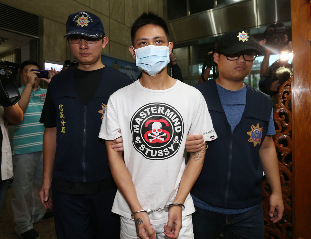 China confirms detention of Taiwanese pro-democracy activist