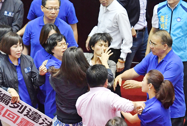 KMT Legislator Hsu Shu-hua slaps DPP legislator Chiu Yi-ying in the face during scuffle over infrastructure budget.
