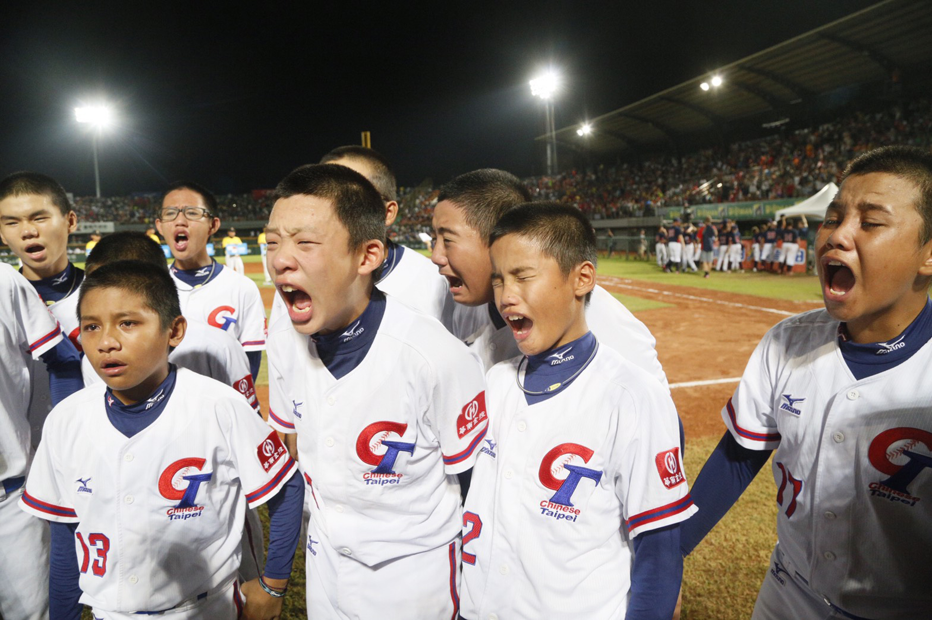 Taiwanese players cry after losing to US in U12 Baseball World Cup final.