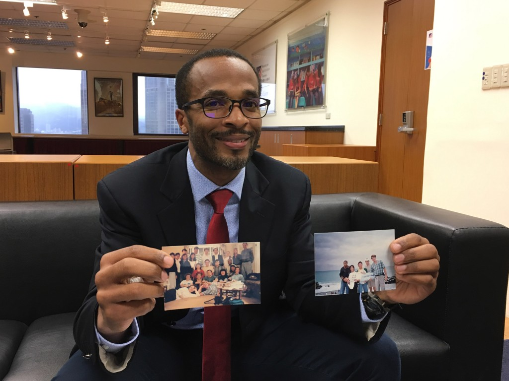 AIT official Eric Aldrich shows pictures of his early stay in Taiwan.