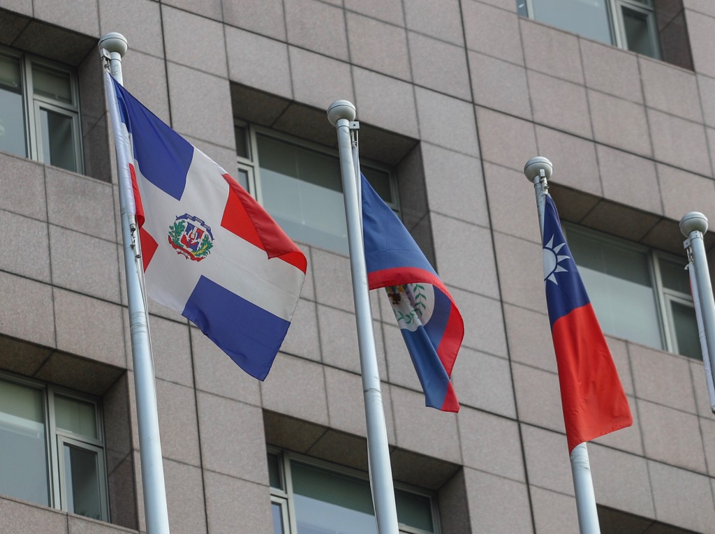 The flag of the Dominican Republic (left).