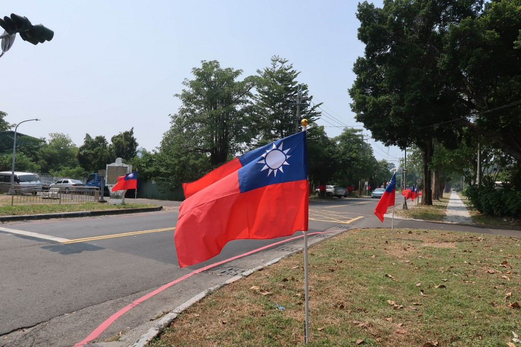 Taiwanese flags line a street in Kaohsiung.