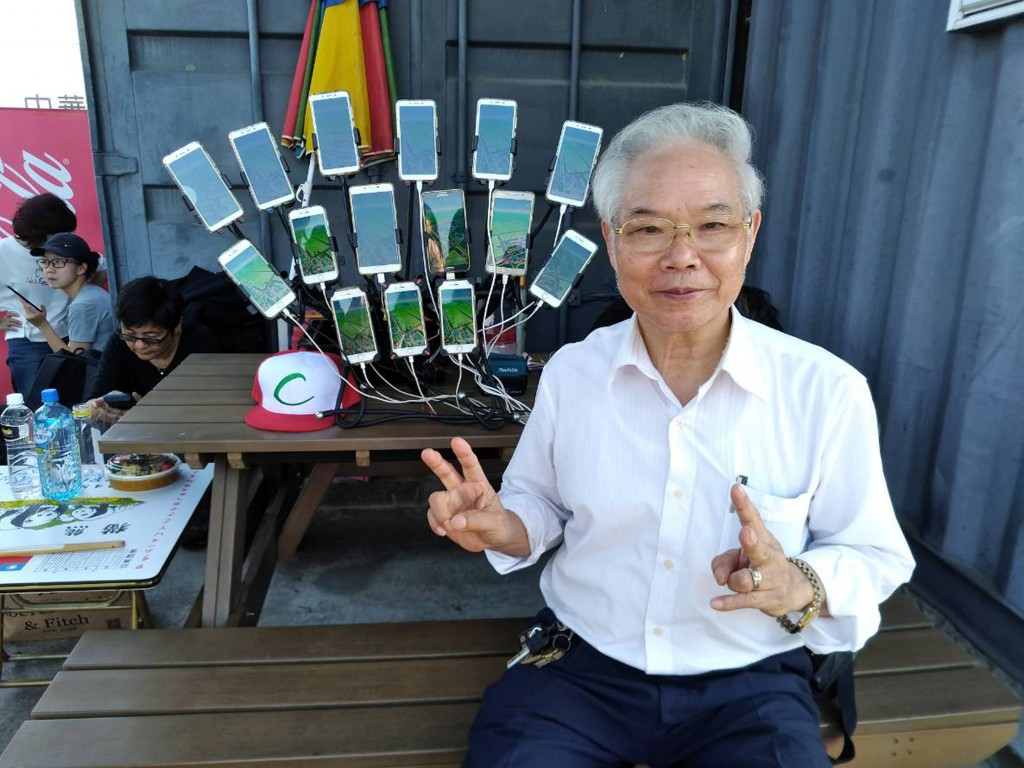 Chen San-yuan and his phones, out Pokemon hunting in Tainan.