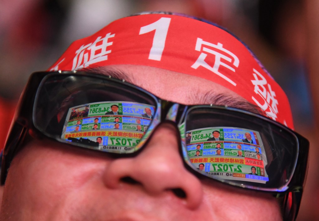 A Han Kuo-yu supporter watching results come in.