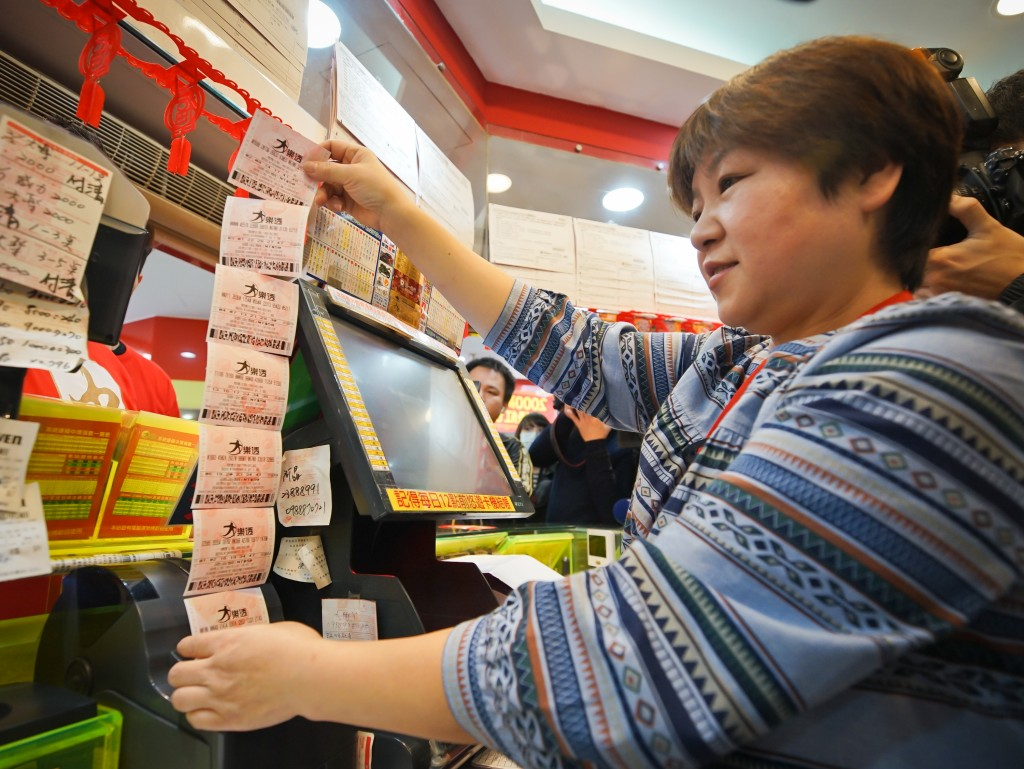 Stock image of lottery store clerk.