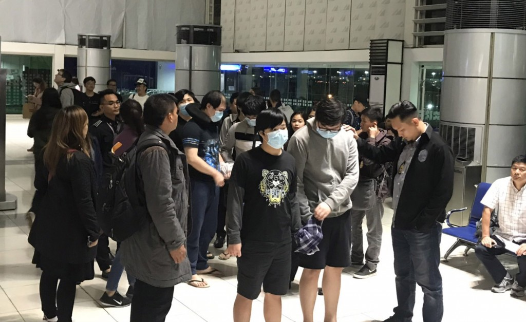 Seven Taiwanese fraud suspects await deportation to Beijing at Manila International Airport Feb. 12
