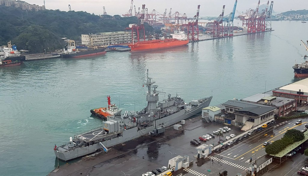 A Saudi tanker (red, in background) smashed into a Navy frigate (foreground) in Keelung early Saturday.