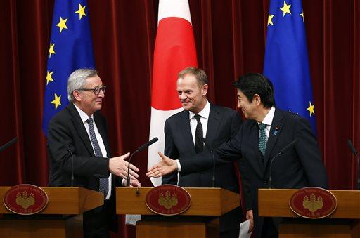 Japan, EU agree to step up defense, economic ties