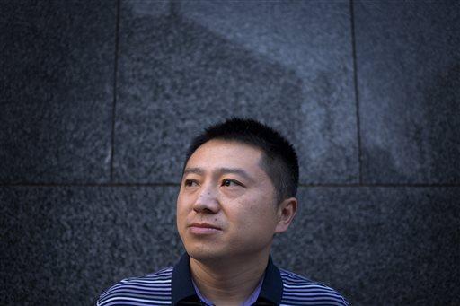 China journalist refuses to confess despite police pressure