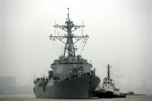 China warns US Navy after ship sails by Chinese-built island
