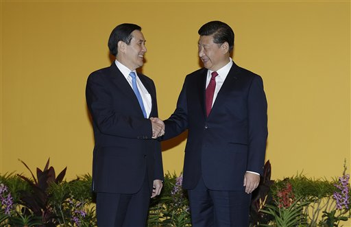 China, Taiwan leaders shake hands for 1st time