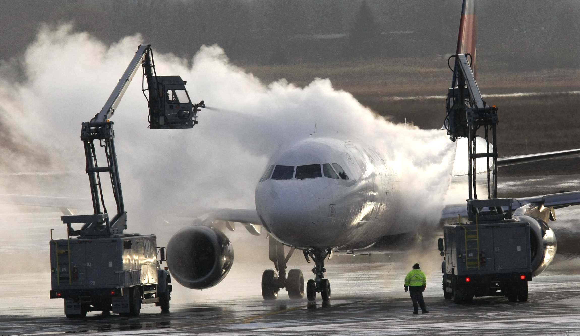 A Delta Airlines plane is deiced at the Detroit Metropolitan Airport in Romulus, Michigan on Sunday.