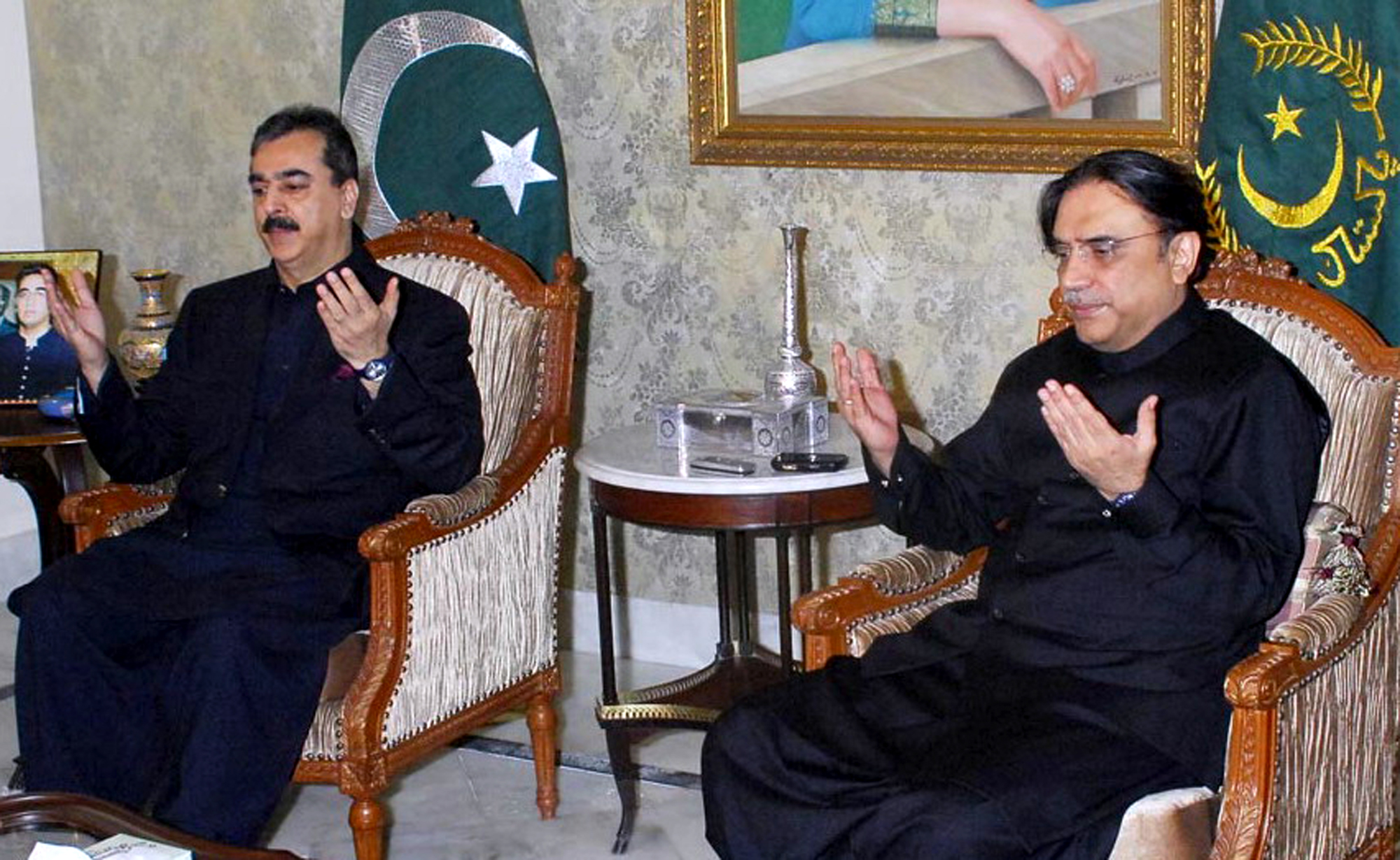 In this photo released by Pakistan Press Information Department, President Asif Ali Zardari, right, and Prime Minister Yousuf Raza Gilani pray during ...
