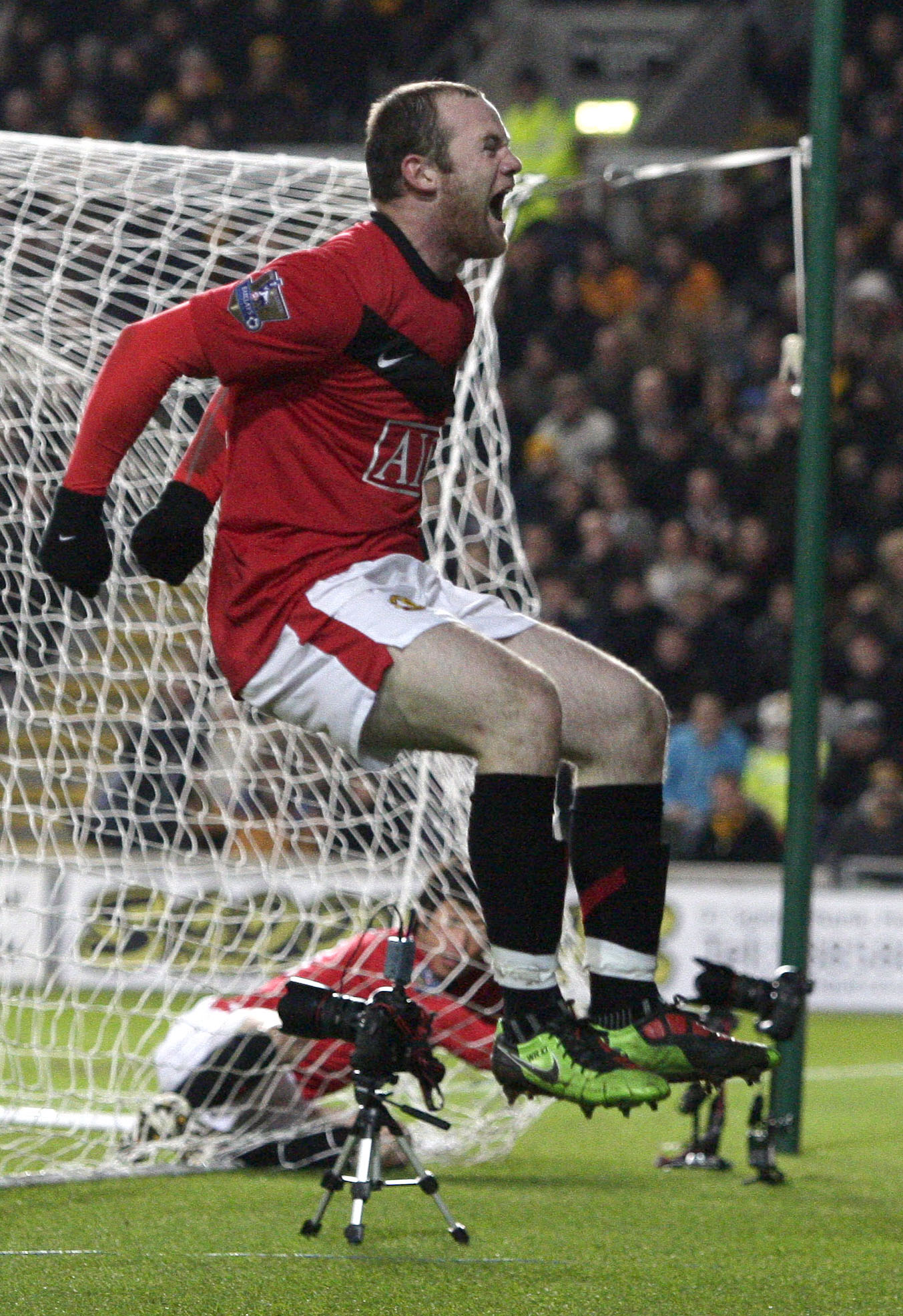Manchester United's Wayne Rooney celebrates after scoring against Hull City during their English Premier League soccer match The KC Stadium, Hull, Eng...