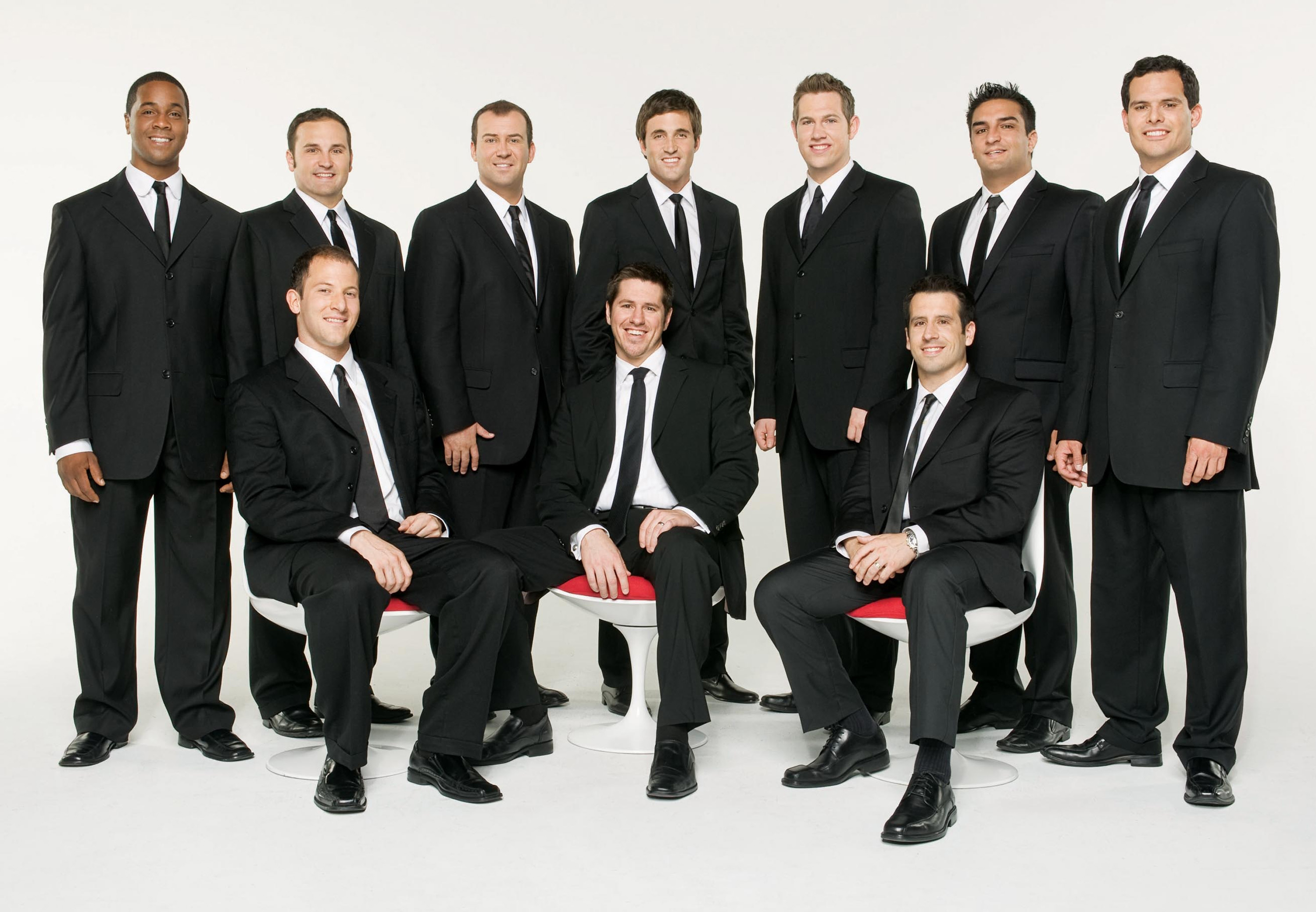 In this publicity image released by Atlantic Records, the A cappella group Straight No Chaser, standing from left, Jerome Collins, Tyler Trepp, Randy ...