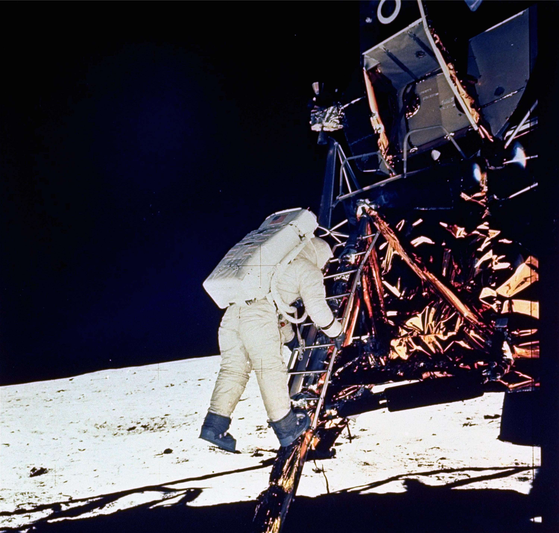 Astronaut Edwin E. Aldrin, Jr., lunar module pilot, descends steps of Lunar Module ladder as he prepares to walk on the moon in this July 20, 1969 fil...