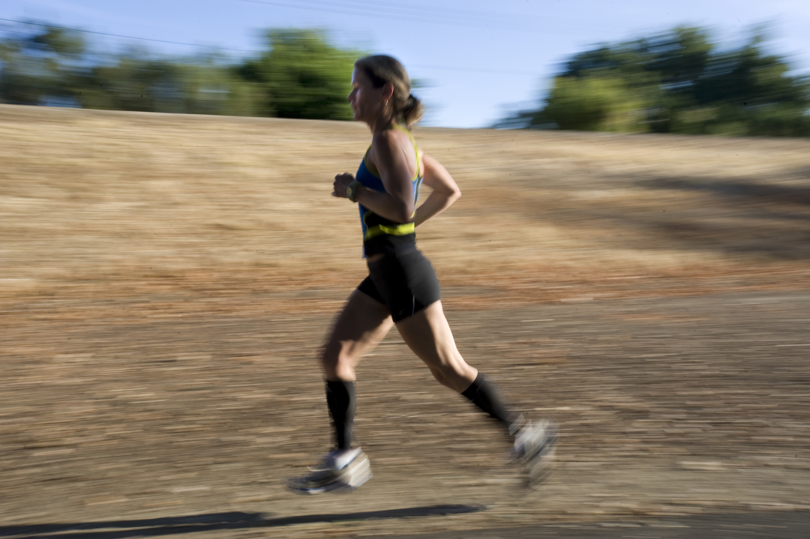 Jaymee Marty, 42, of Sacramento, runs along the American River bike trail, Sep. 17, 2009. Marty, who barely missed qualifying for the Olympic Trials i...